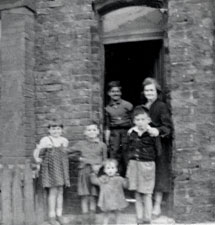Chrissie (far left) with her brothers and mother, after World War 2